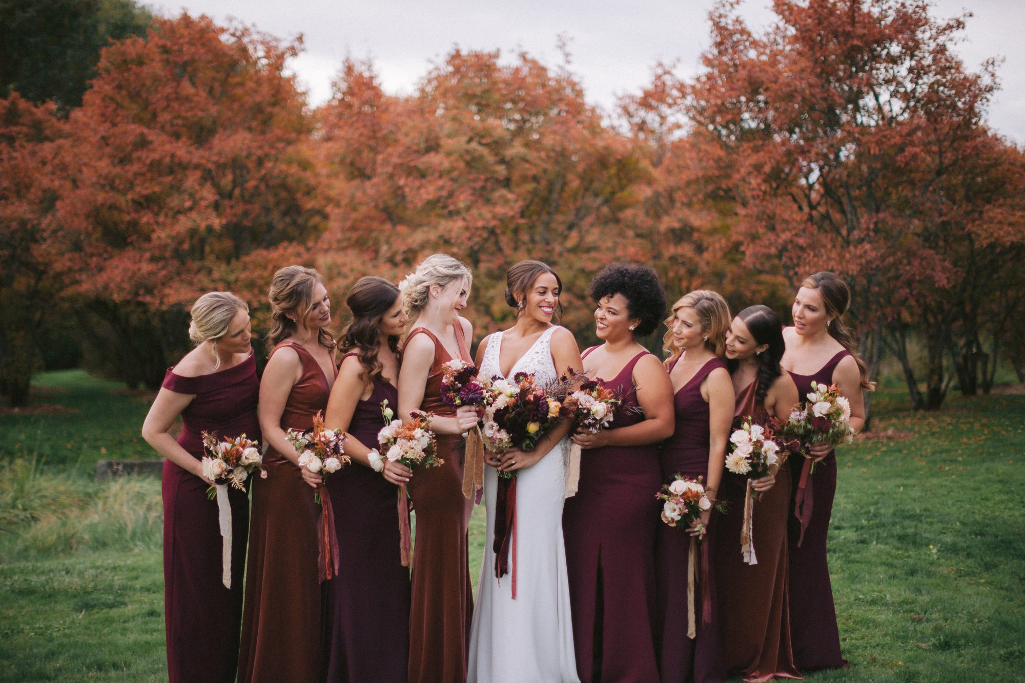 bridesmaids wearing red dresses