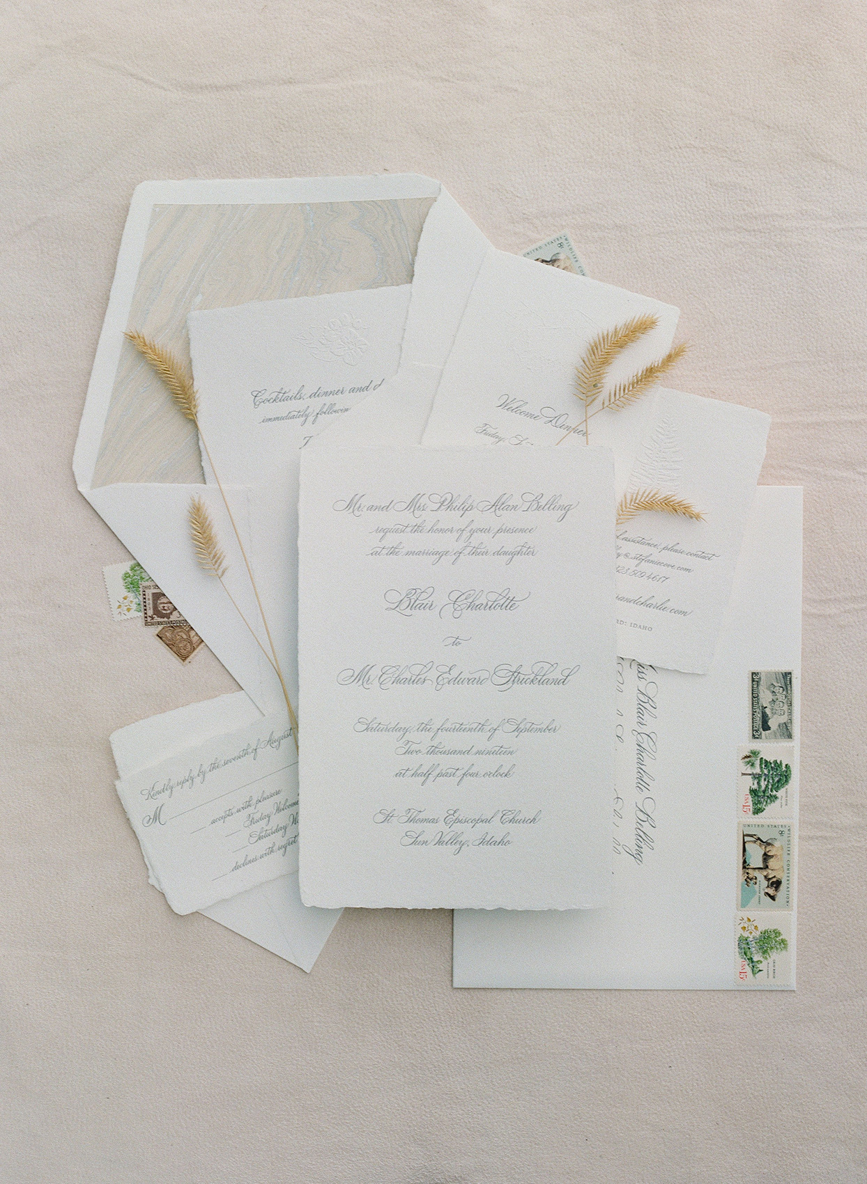 simple white wedding invitations with rough edges and script font