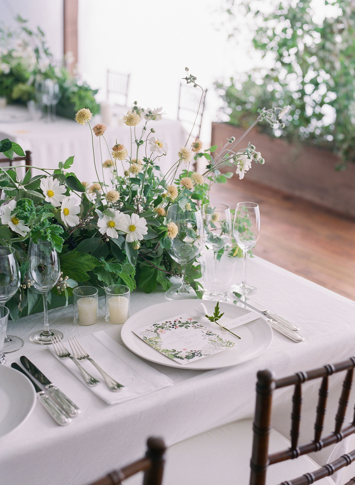 simple wedding place setting with wildflowers and candles