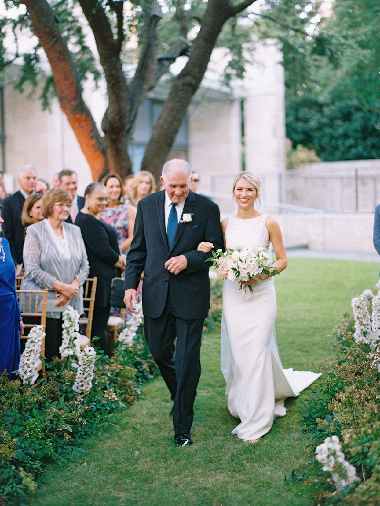 bride and father processing down grass aisle