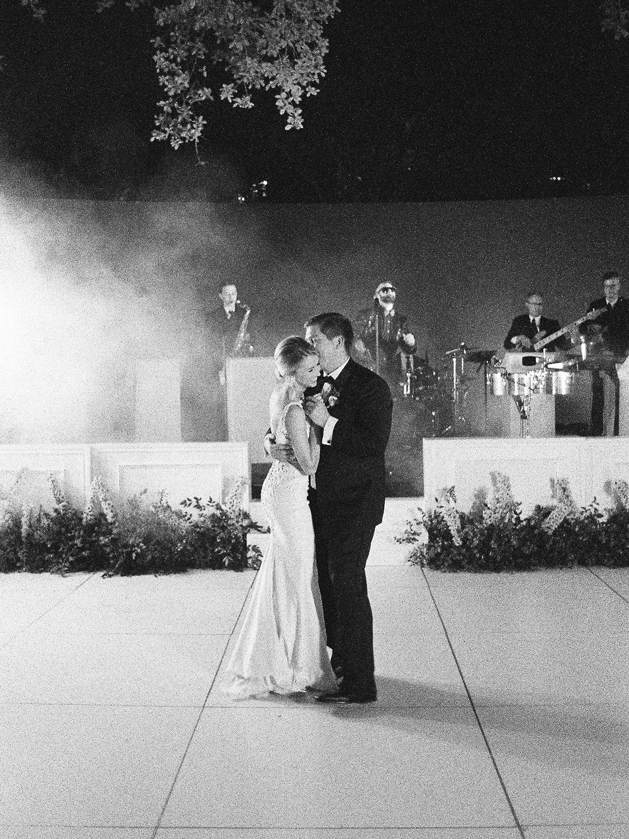 wedding couple embracing during first dance
