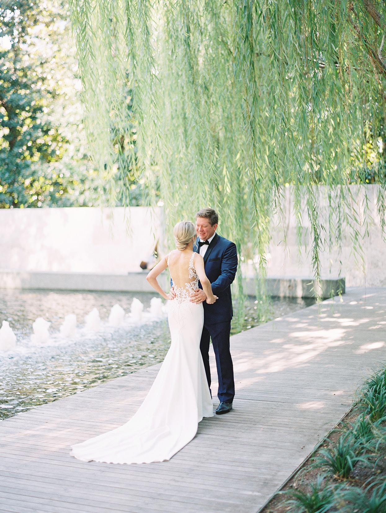 wedding couple first look on boardwalk under willow tree