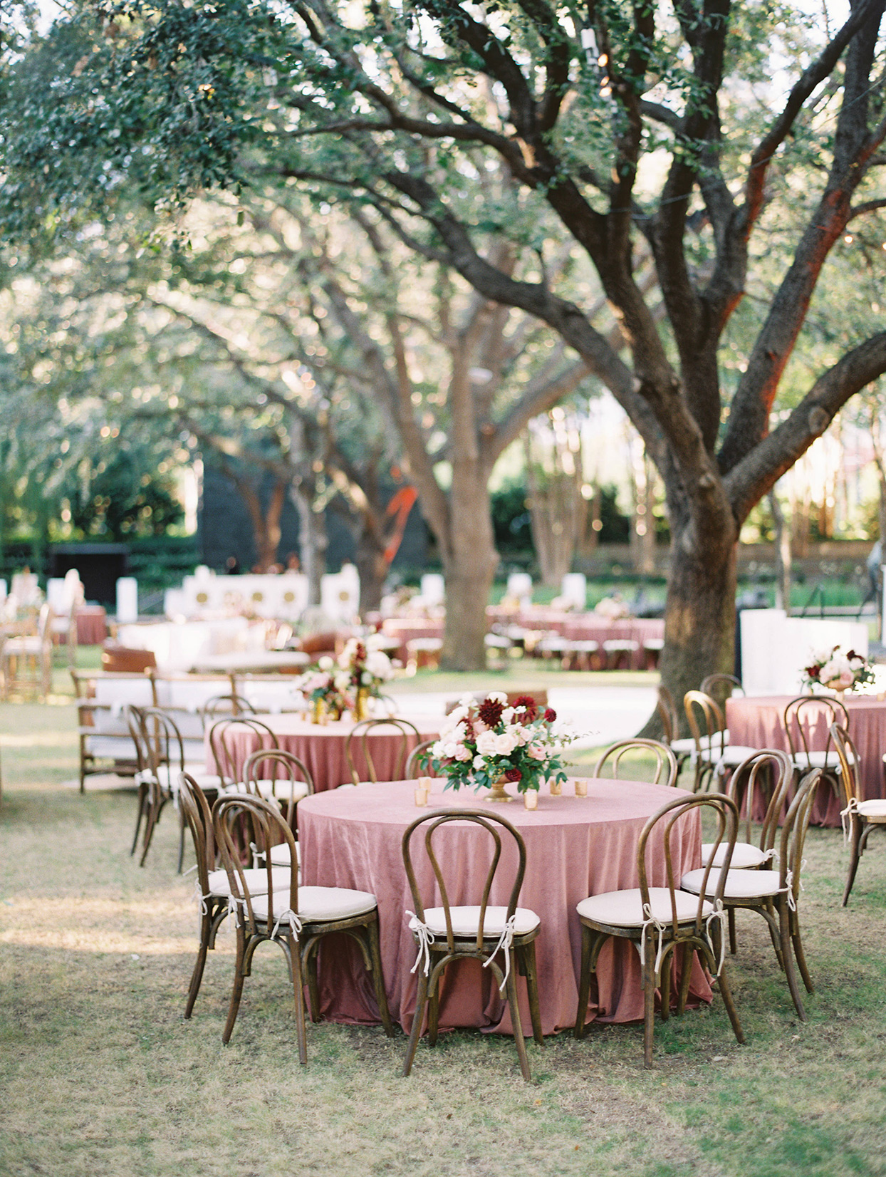 outdoor reception round tables with muted red table cloths