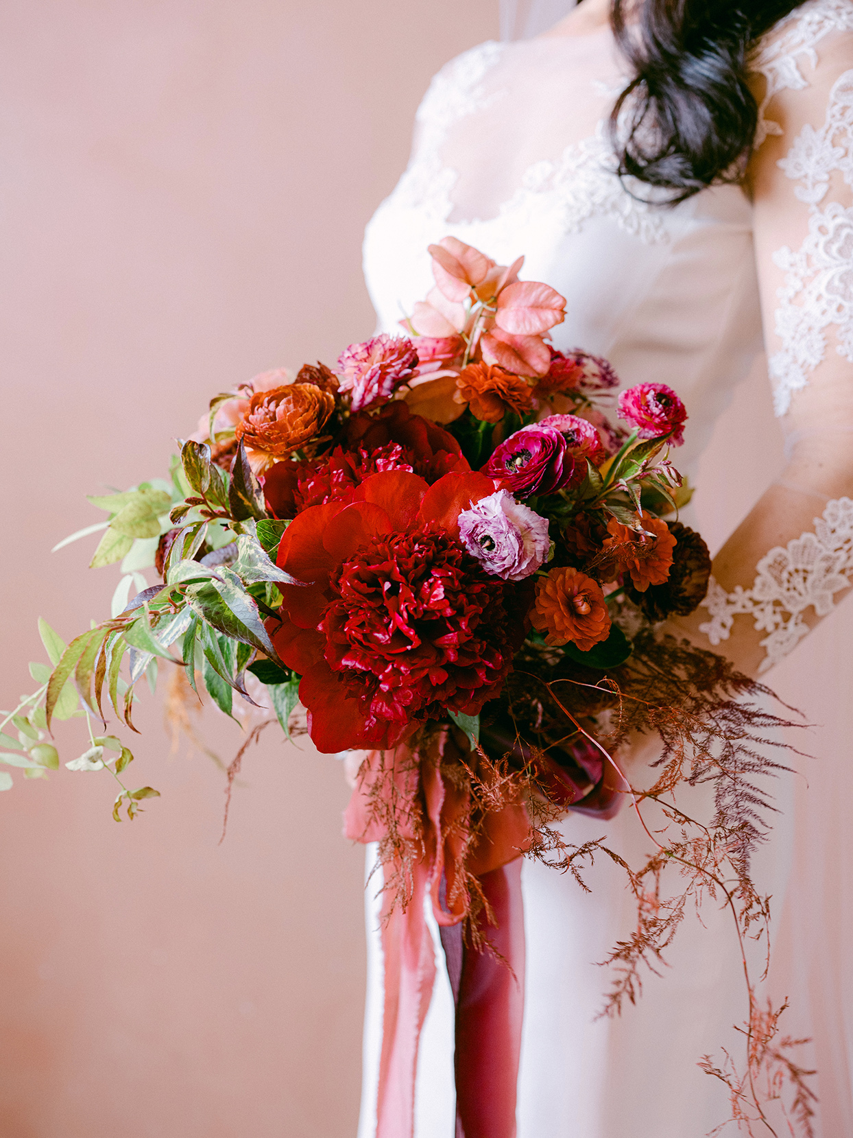 red and orange floral wedding bouquet