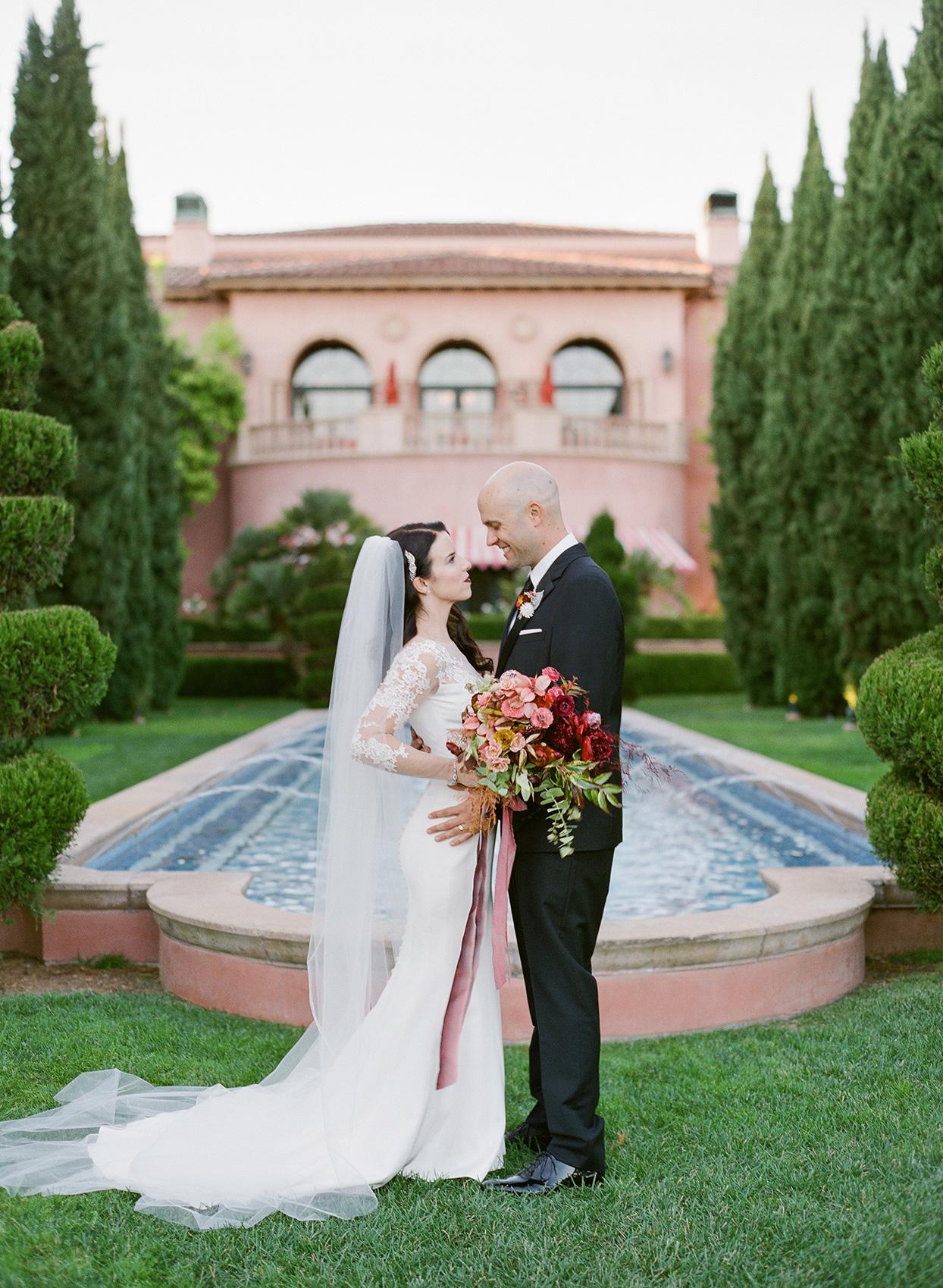 bride and groom in elegant wedding attire portrait at hotel