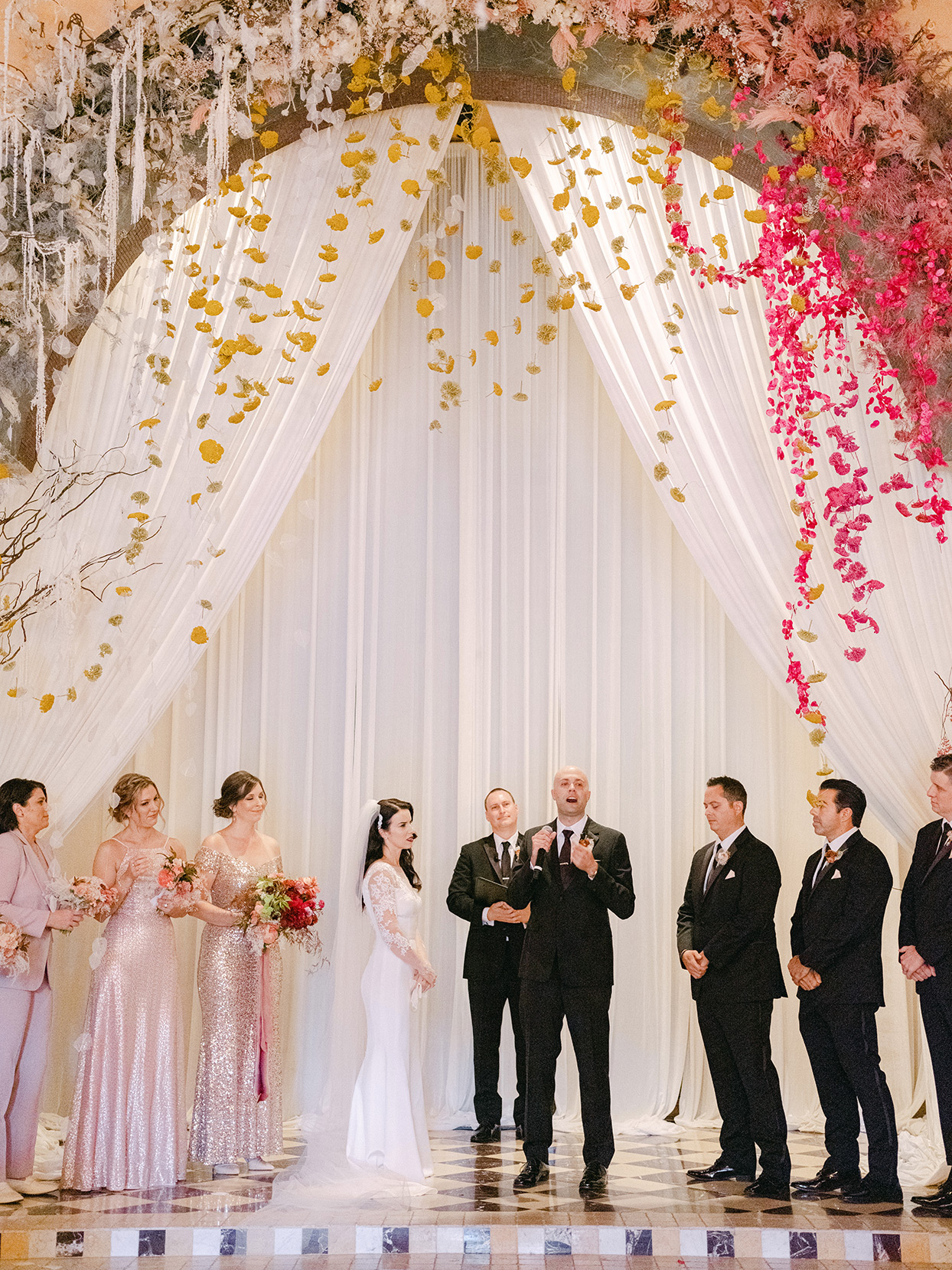 groom addressing guests during wedding ceremony