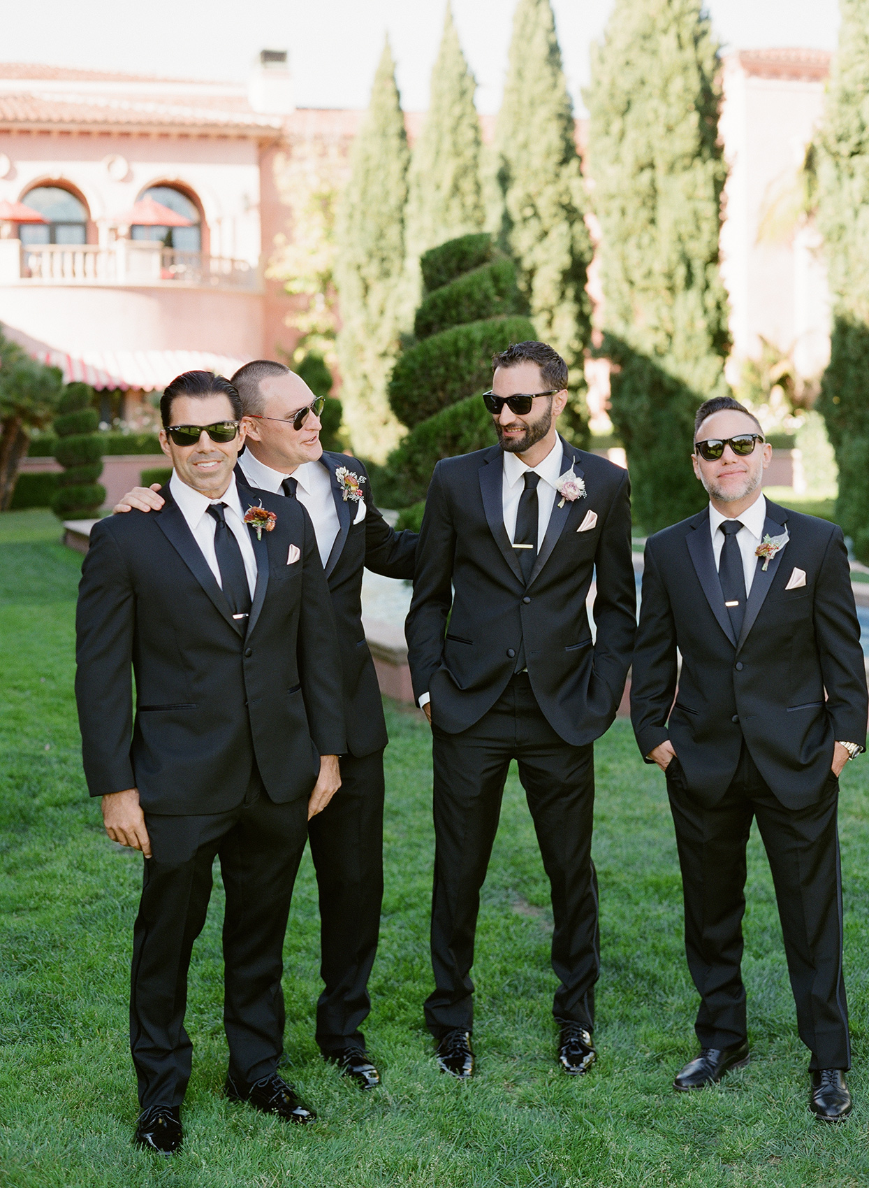 wedding groomsmen in black suits and sunglasses