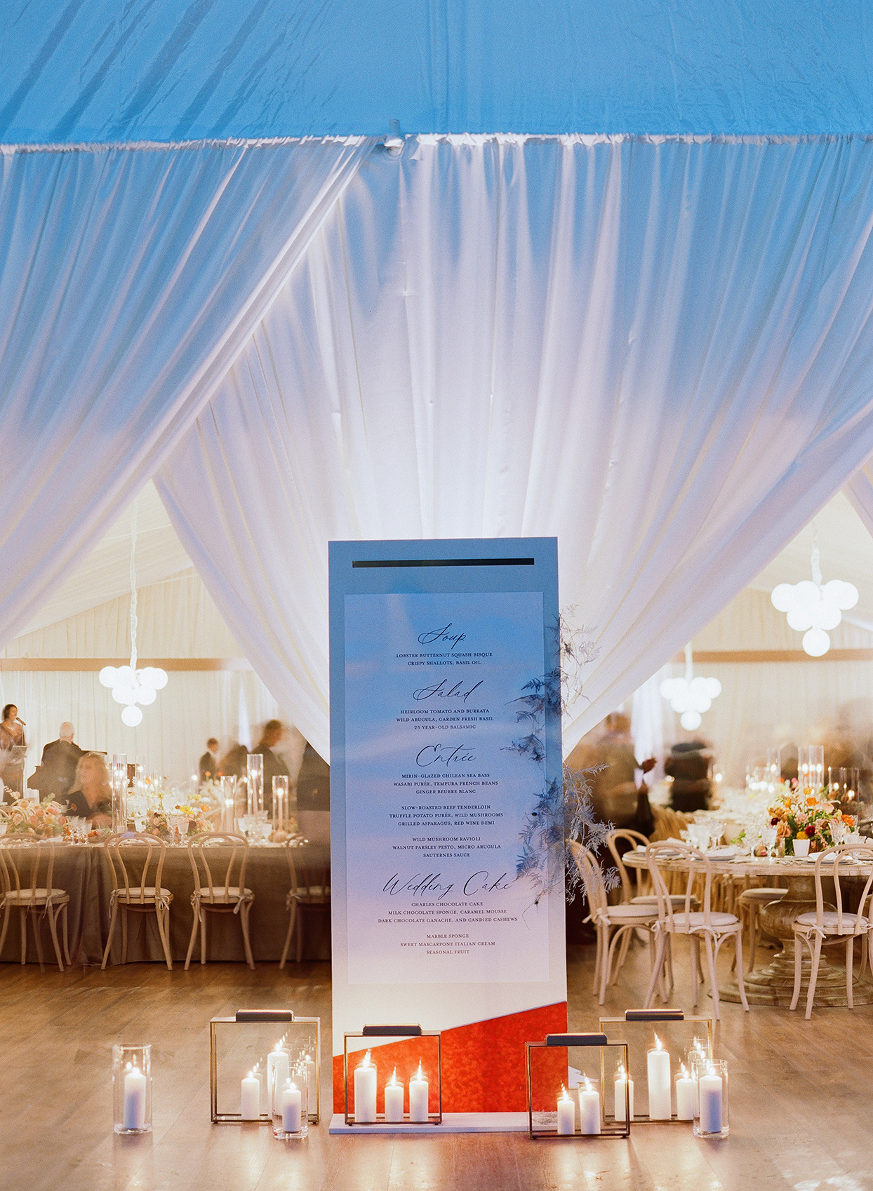 large reception dinner menu with candles below