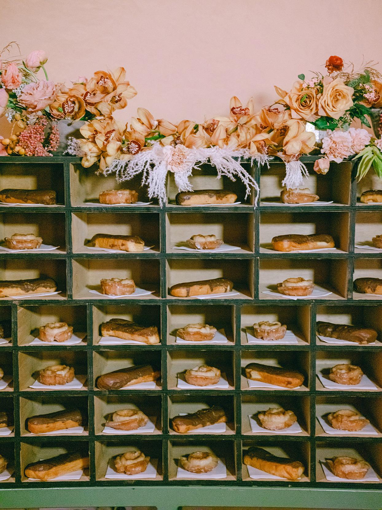 antique wooden shelf with wedding dessert pastries
