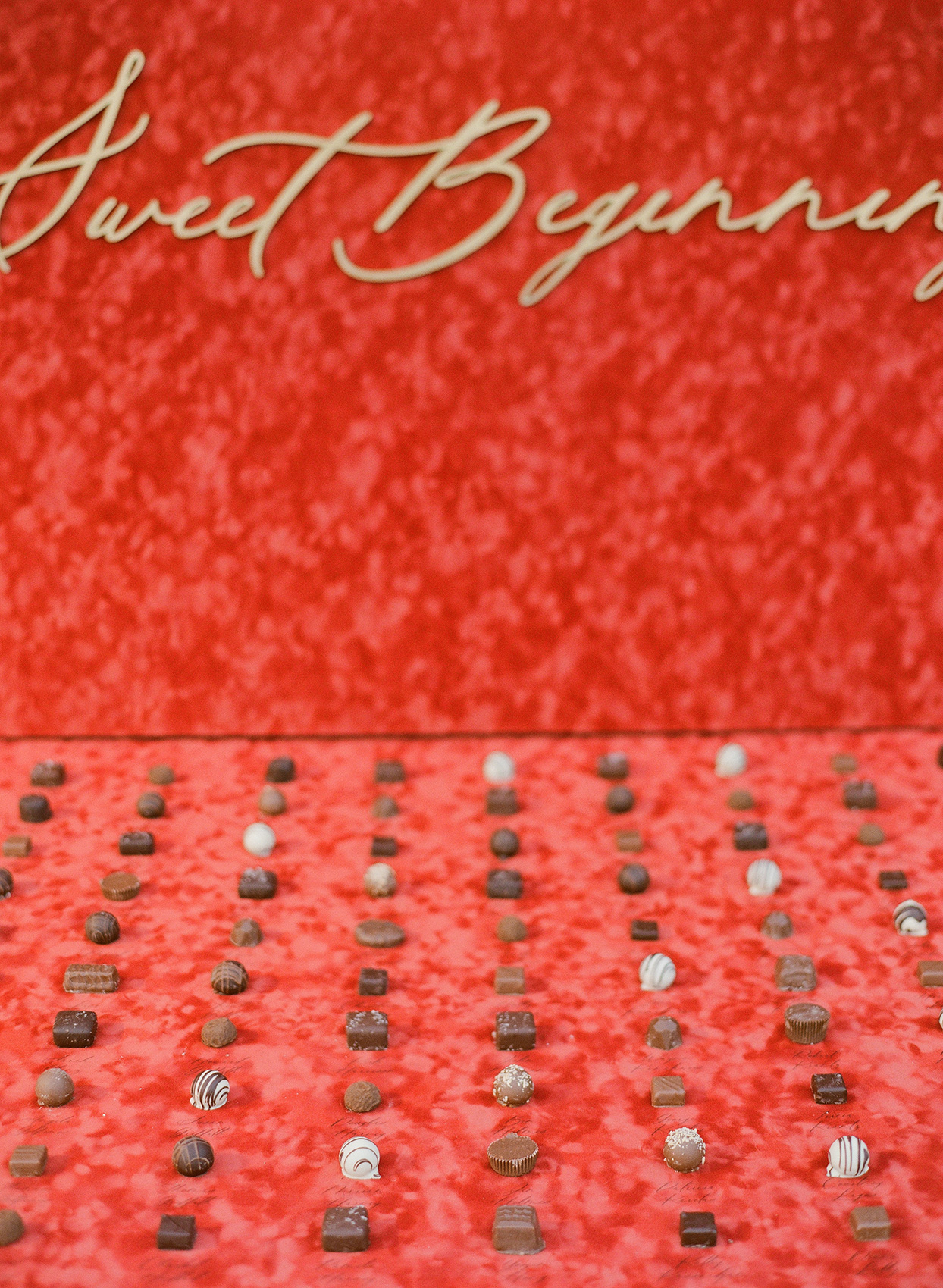 red backdrop chocolate truffle dessert station