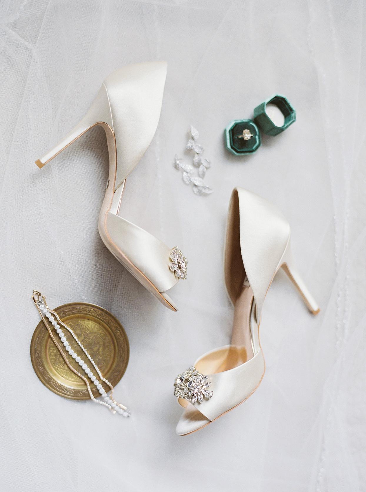 bride's elegant white heels, jewelry