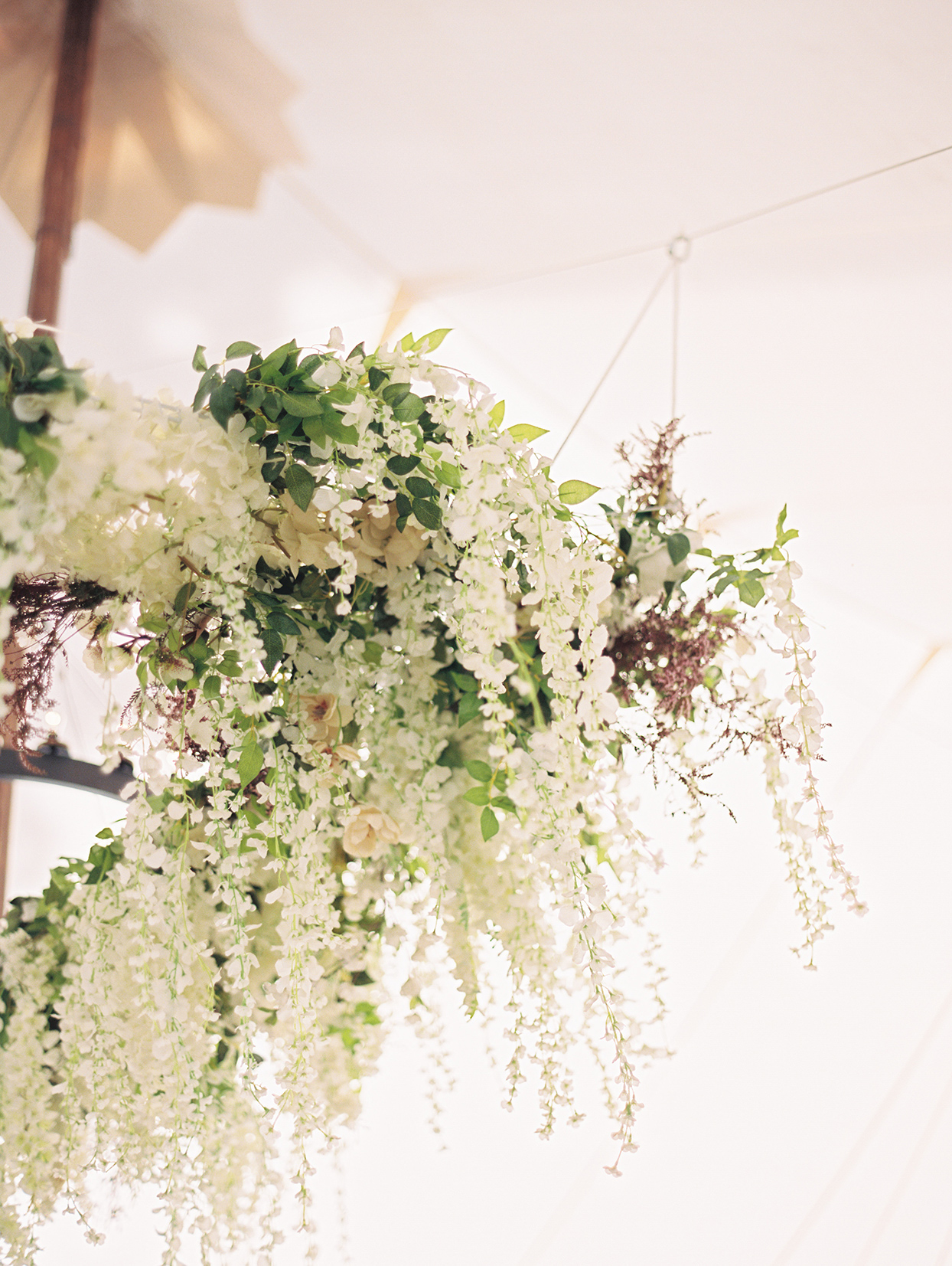 hanging floral chandelier at wedding reception