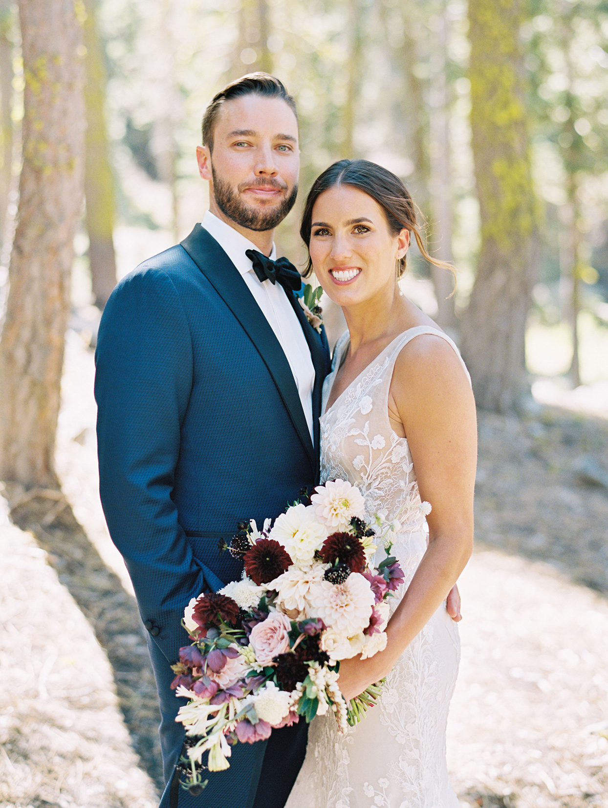 wedding couple portrait outdoors with lush bouquet