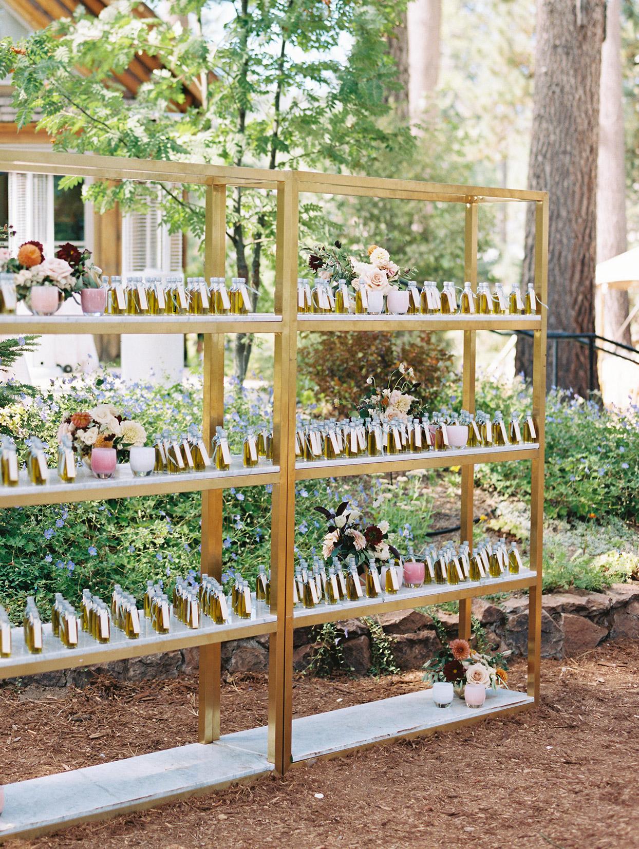 bottle escort cards on golden stands at reception
