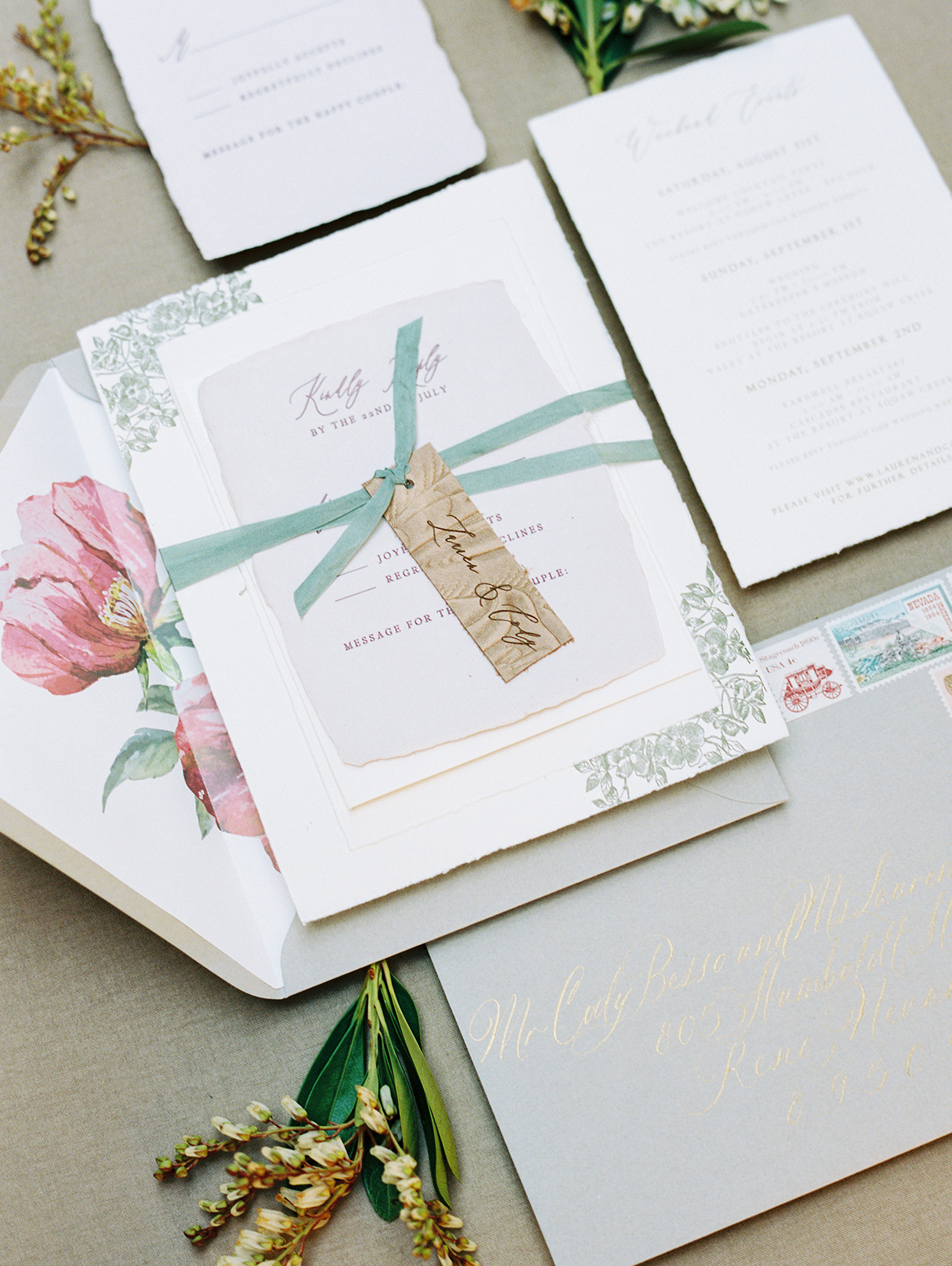elegant pink, white, and gold wedding invitations with teal accent