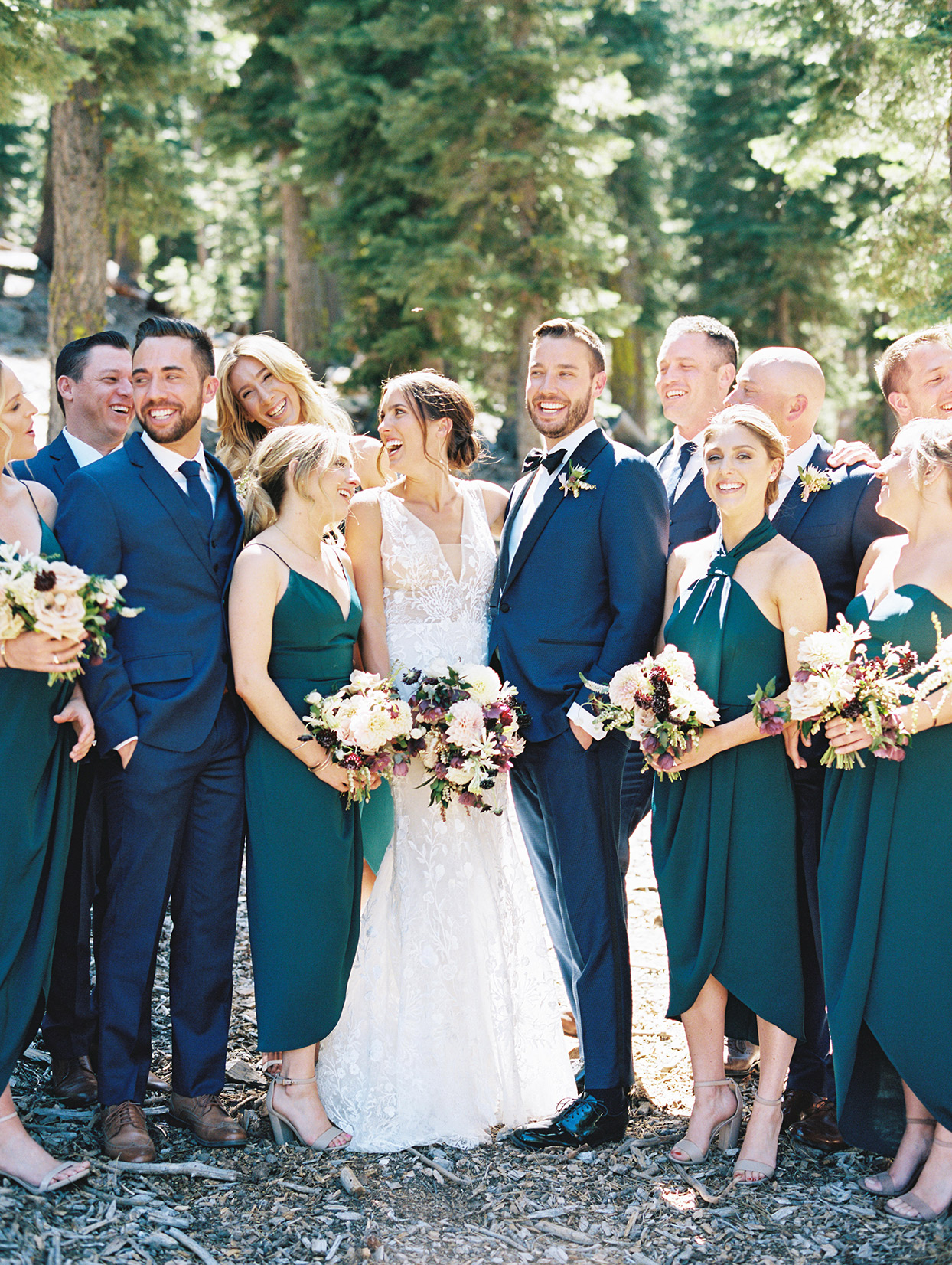 wedding party in blue and teal with purple tones bouquets
