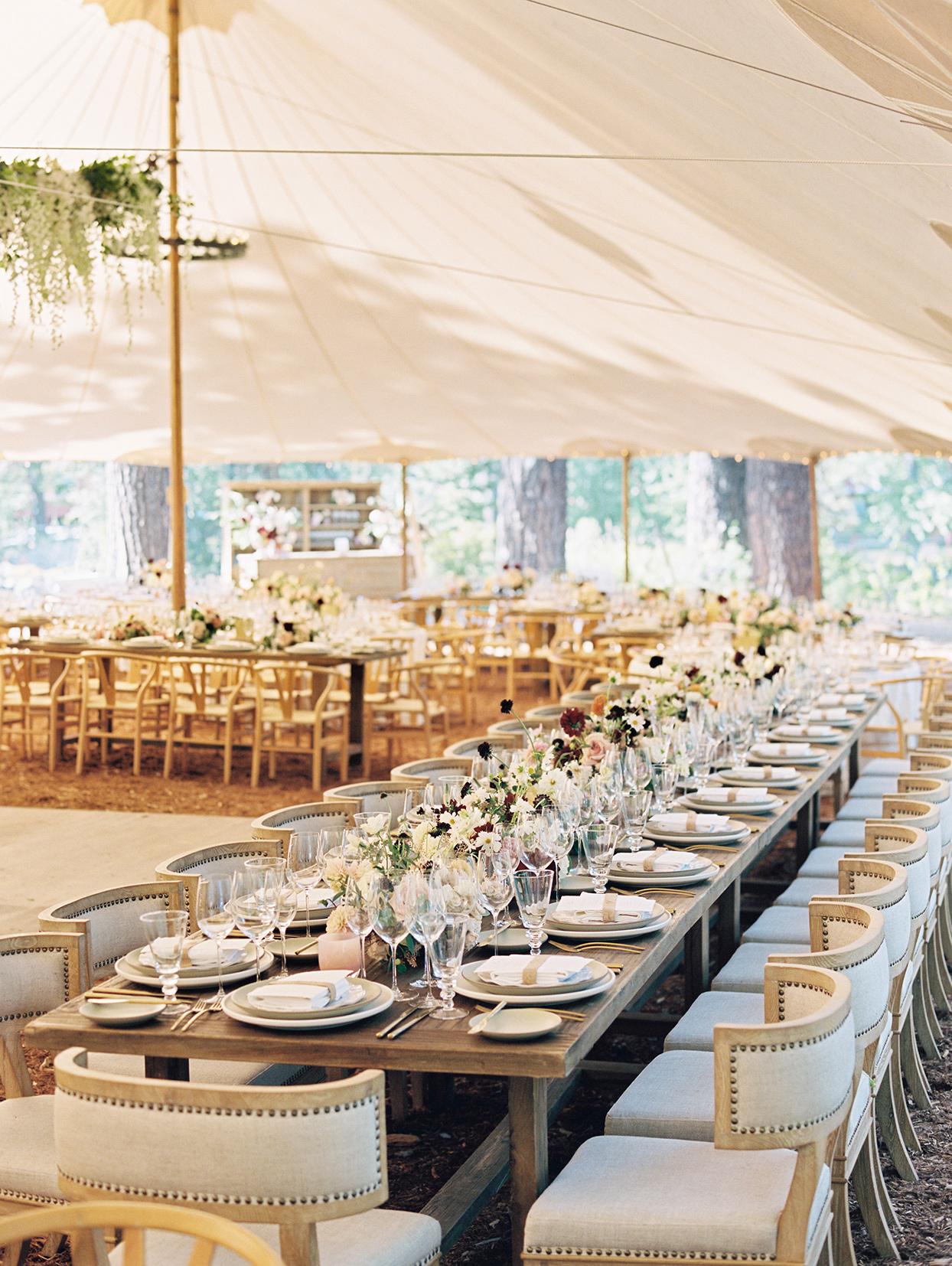 elegant long tables under tent at wedding reception
