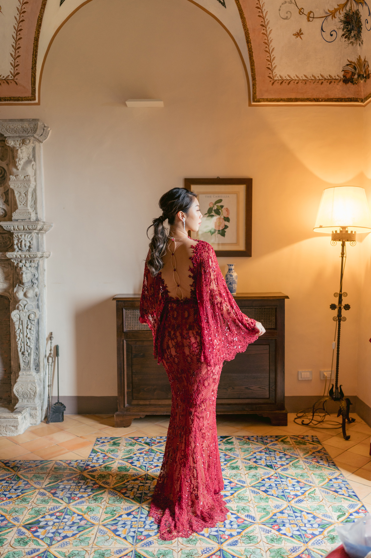 bride wearing detailed lace bell sleeve red dress