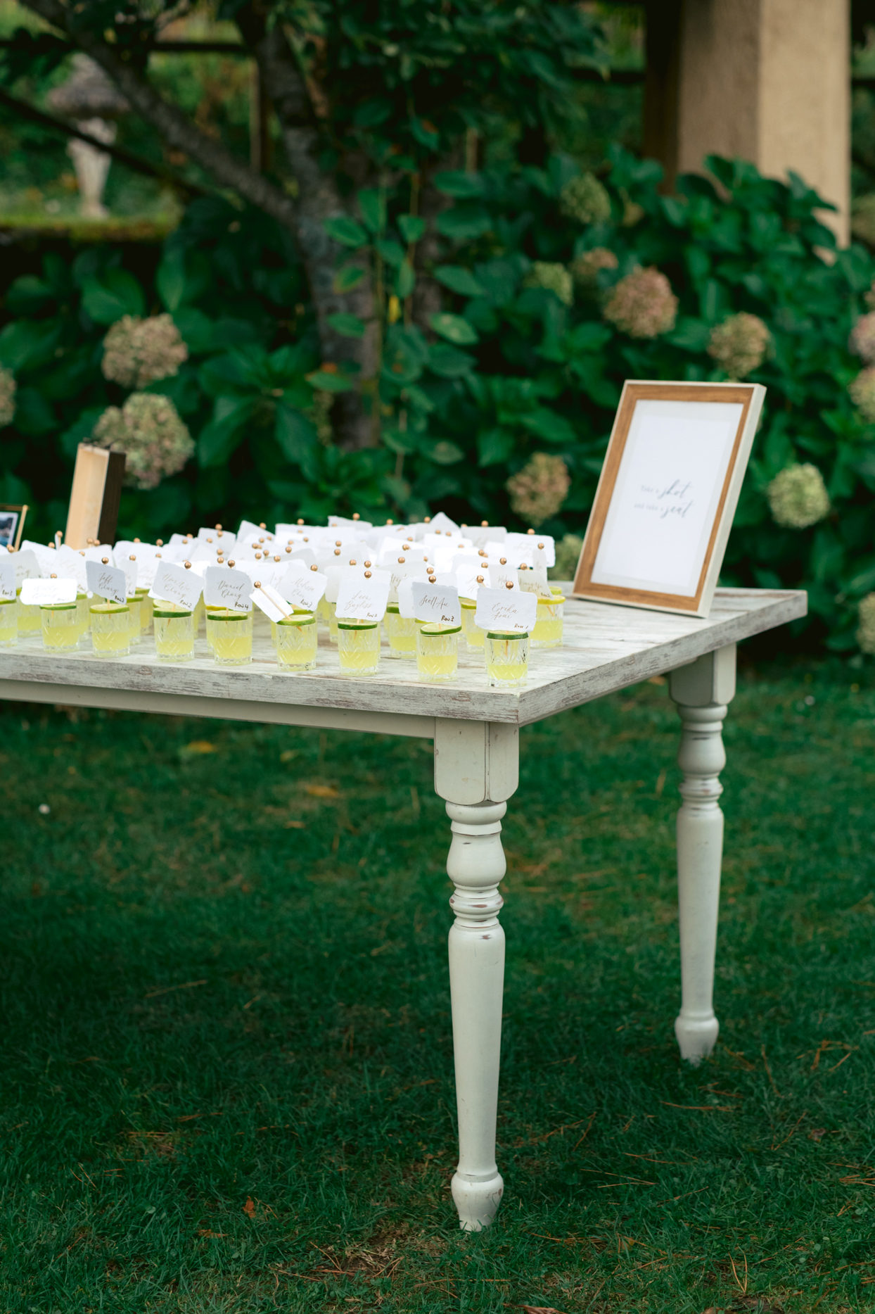 drink seating chart cards on distressed wooden table