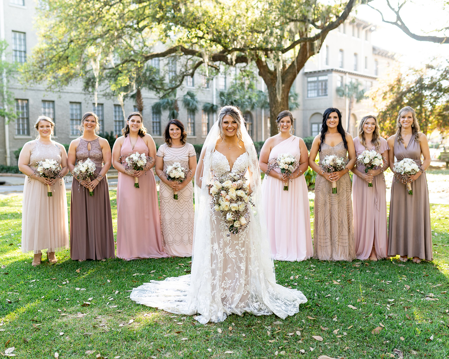 bride and bridesmaids in shades of pink