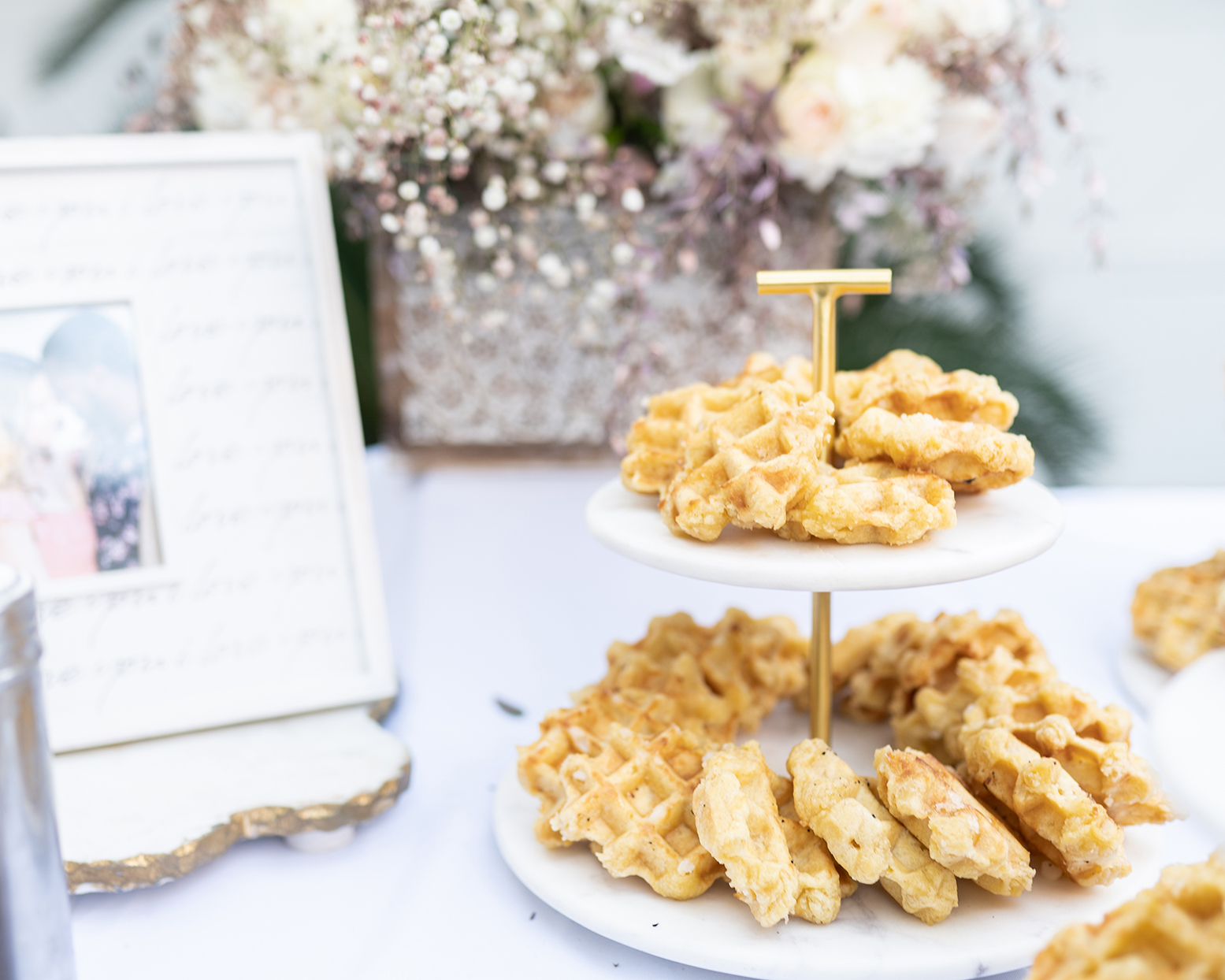 wedding brunch table with waffle bites on stand