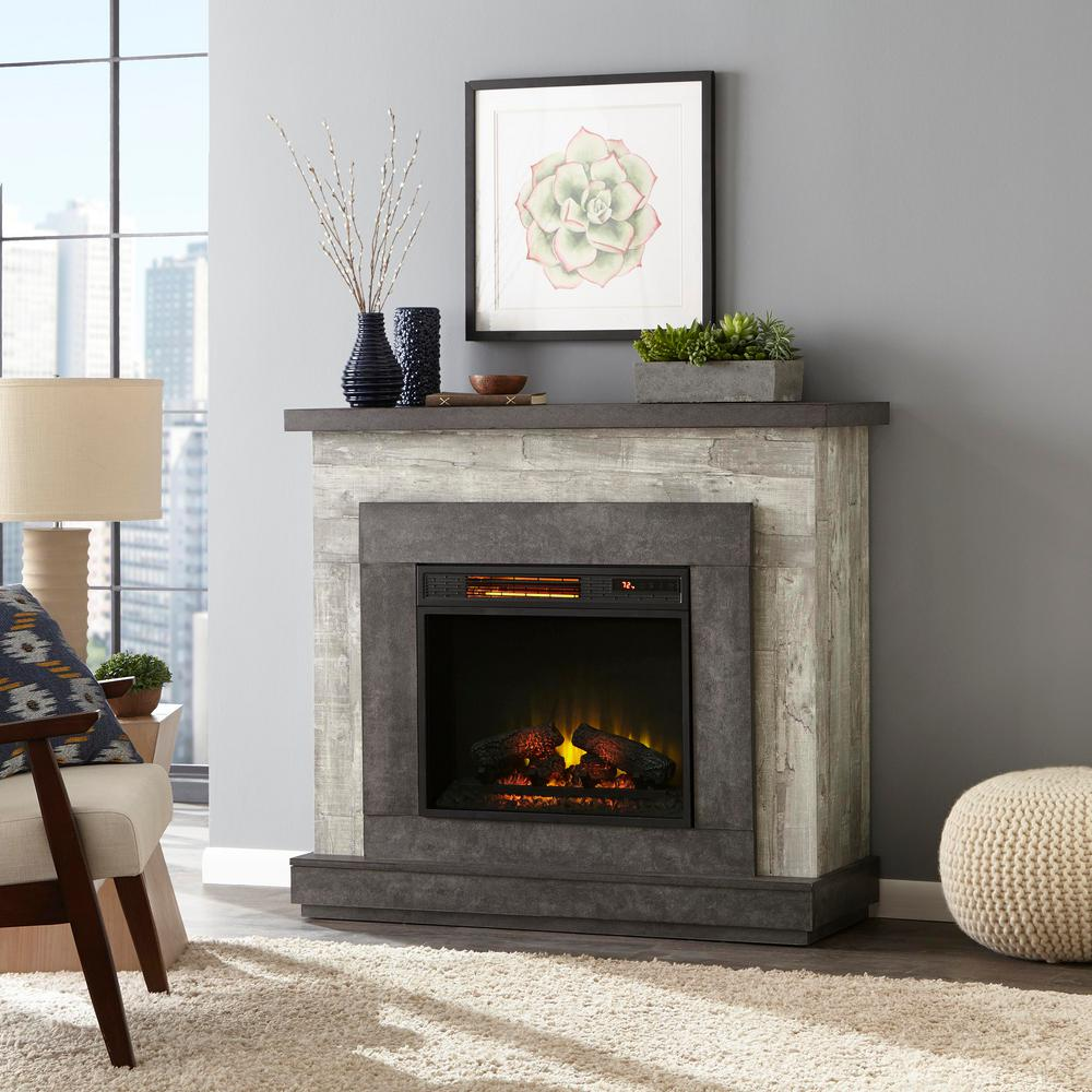 electric fireplace heater in living room next to rug