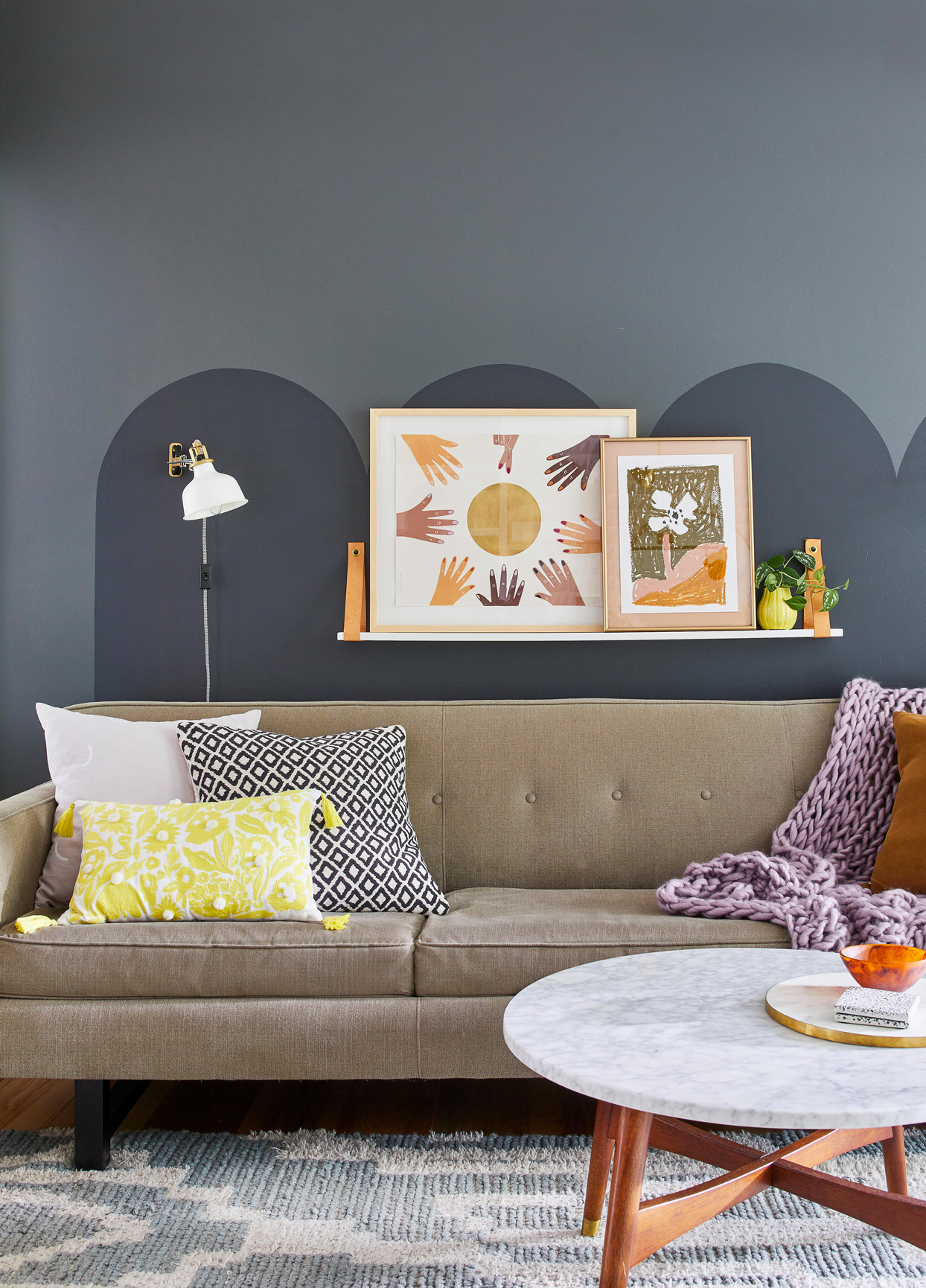 living room with grey wall detail and warm artwork