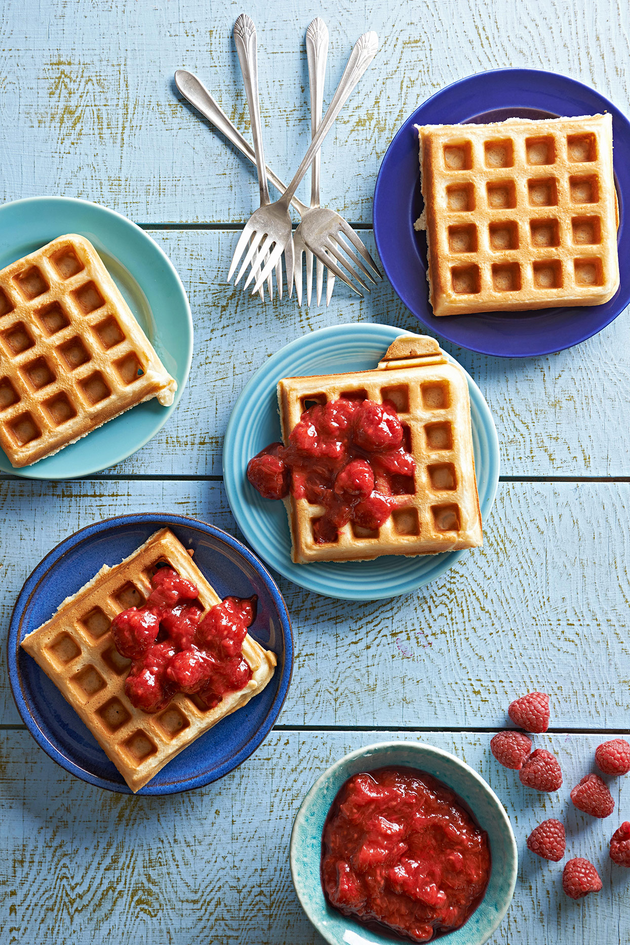 plates of waffles with raspberry-rhubarb topper