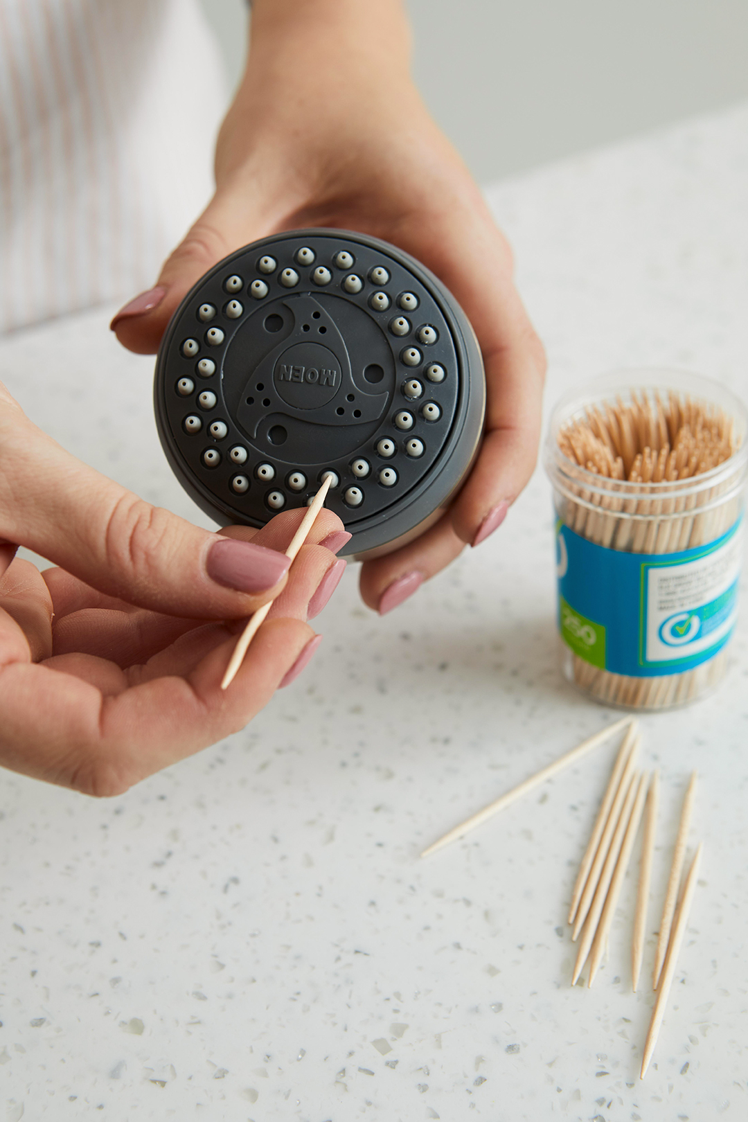 using toothpicks to clean shower head