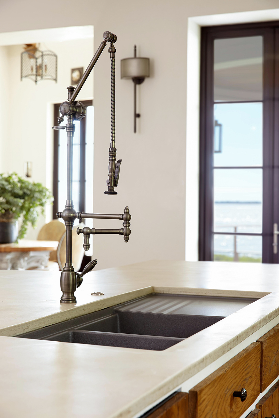 kitchen island built in sink with tall faucet and pasta rack