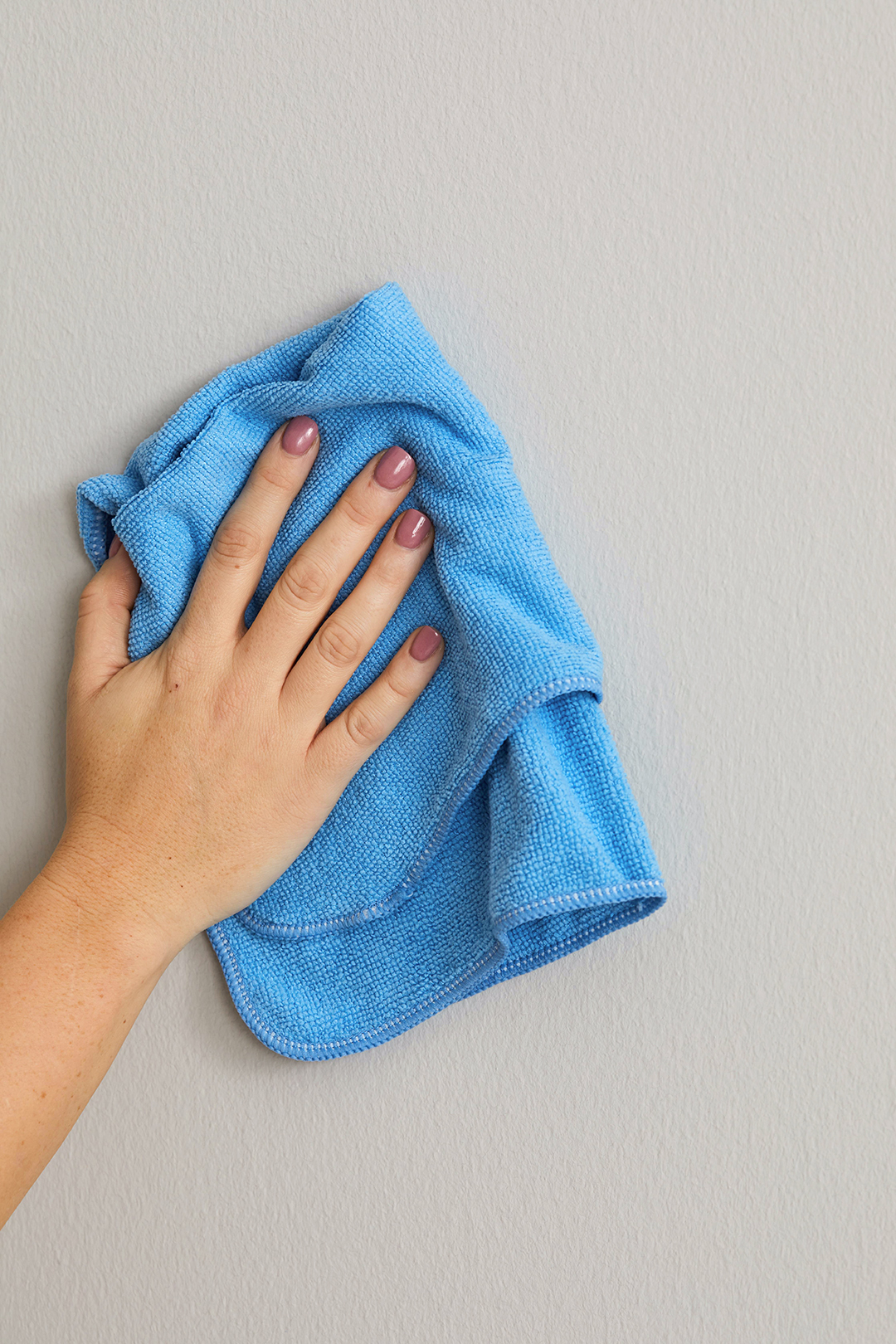 cleaning wall with blue cloth