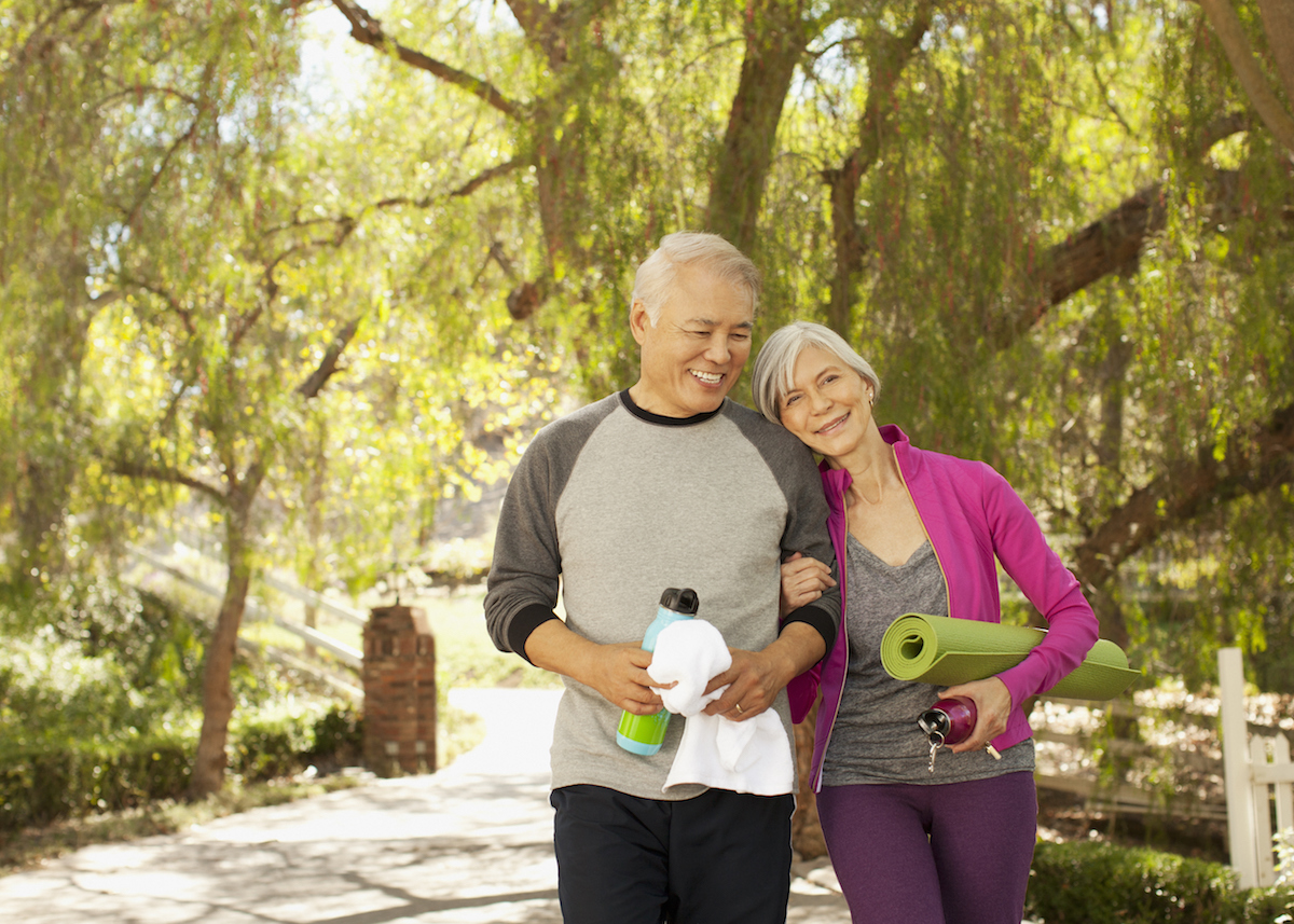 Mature couple walking after yoga class
