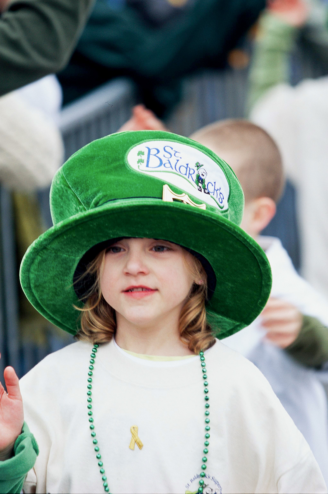 young girl with green st patricks hat and beads