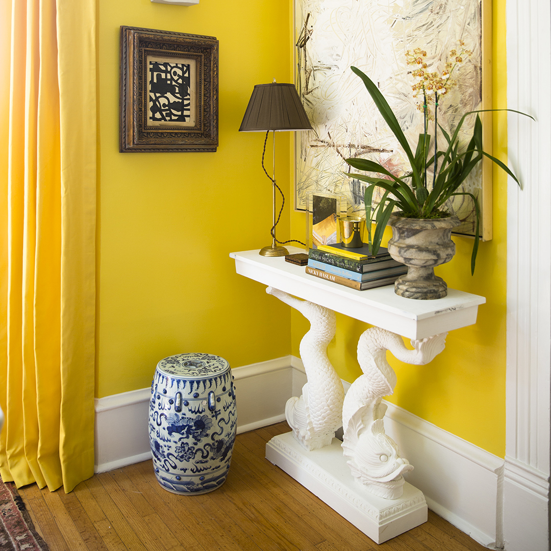 decorative table yellow wall painting