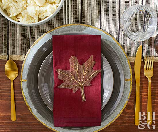 thanksgiving place setting with stitched-leaf napkin