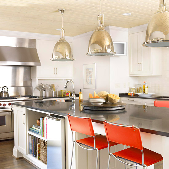 modern kitchen with ambient lighting and red stools