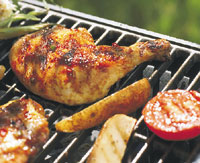 Gas Grill with Chicken and tomatoes