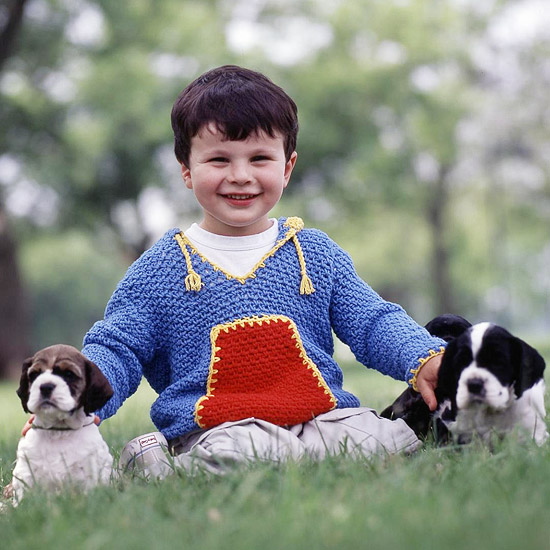 KidCozies_little_boy_in_blue_sweater_with_doggies