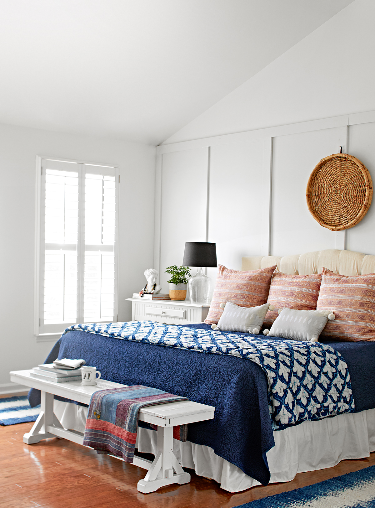 navy and white bedroom with board-and-batten wall trim