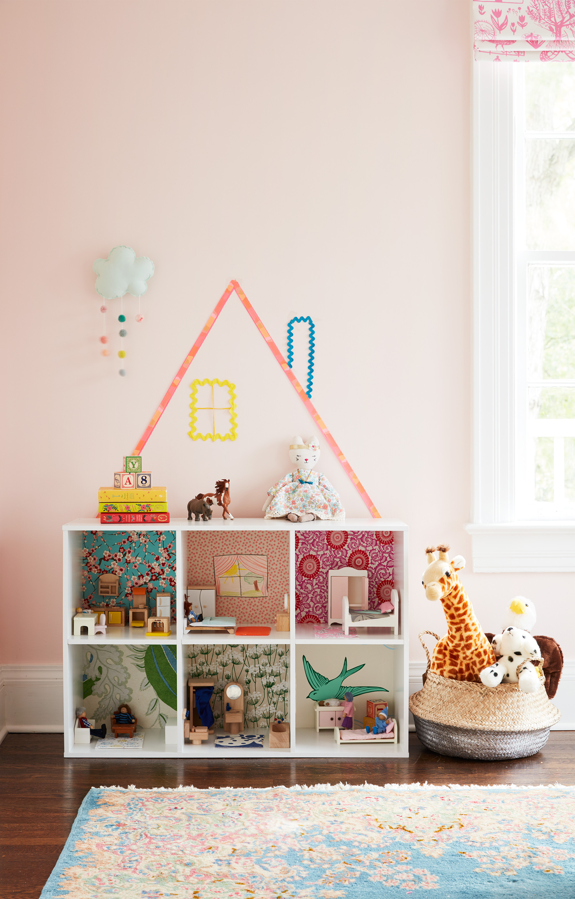 Pink kid's room with dollhouse storage cube