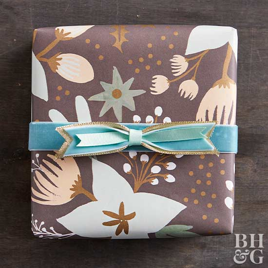 pretty floral wrapped gift with blue ribbon bow