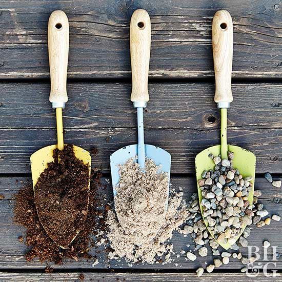 small shovels holding differnt potting mixtures, soil, gravel and sand