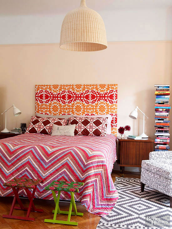 Multiple patterns used for bed linens and headboard