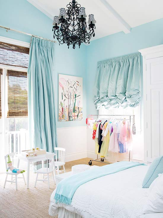 Light blue bedroom with chandelier and ruffle curtains