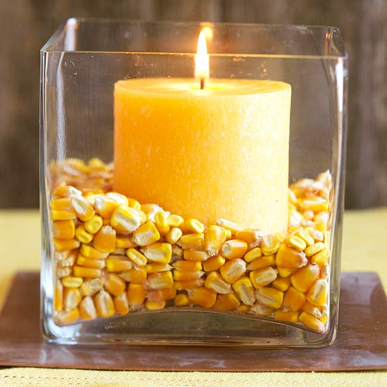 Candle in glass jar as centerpiece