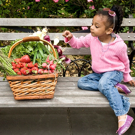 child picking out a vegetable