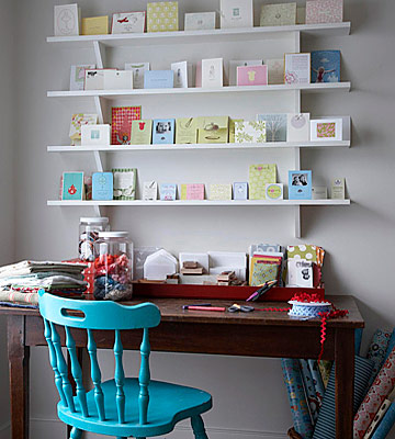 Craft room with desk and shelves