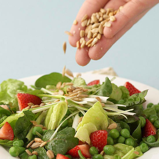 salad topped with sunflower seeds