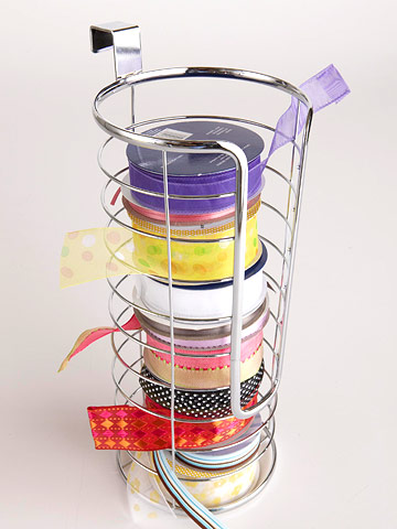 Wire cylinder toilet paper holder filled with ribbon spools