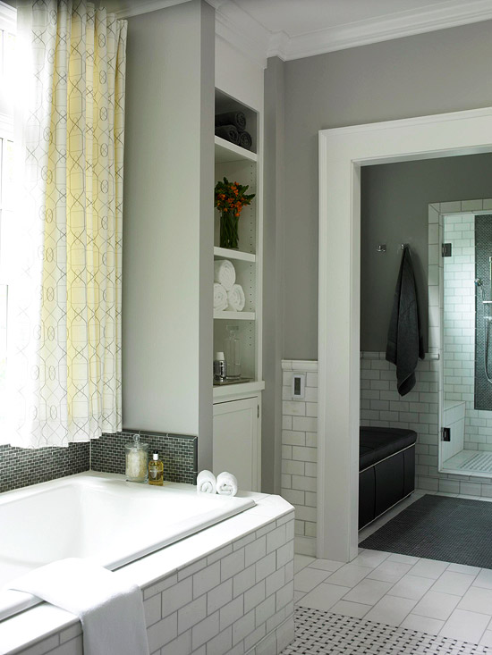 Gray bathroom with recessed shelves